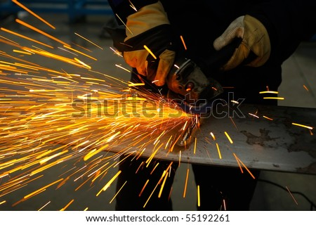 machine for grinding steel and sparks - stock photo