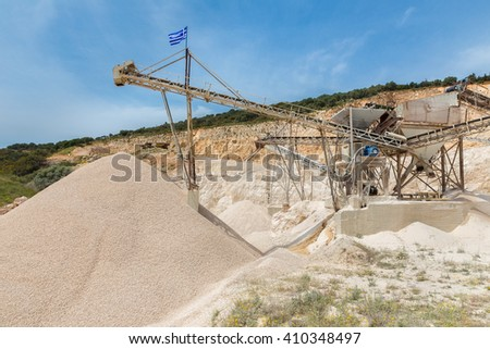 Machine in Greece mining gravel as commodity - stock photo