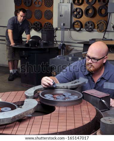 Machine Shop Workers - stock photo