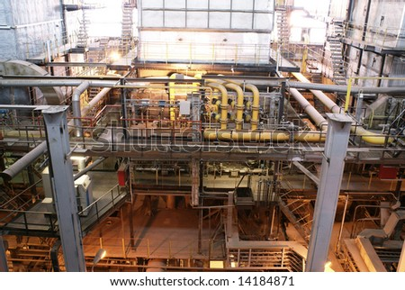 Machinery, pipes, and boilers at factory - stock photo