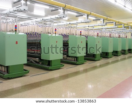 Machines in a textile factory - stock photo