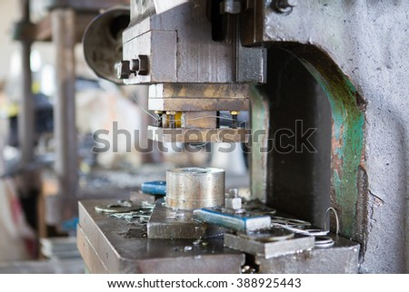 Machining tool drill during metal cutting process boring a hole - stock photo