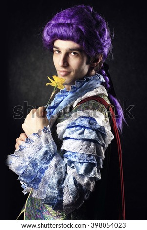 macho with a flower - stock photo