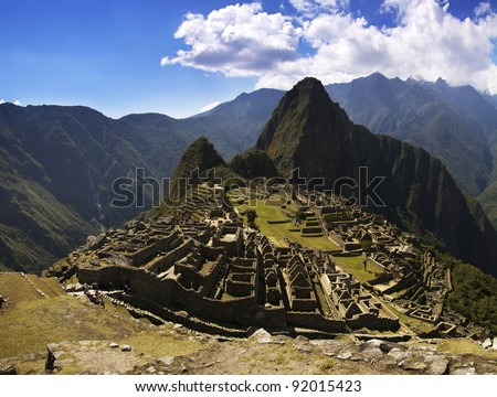 Machu Picchu inca city in the afternoon strong and harsh sunlight. - stock photo