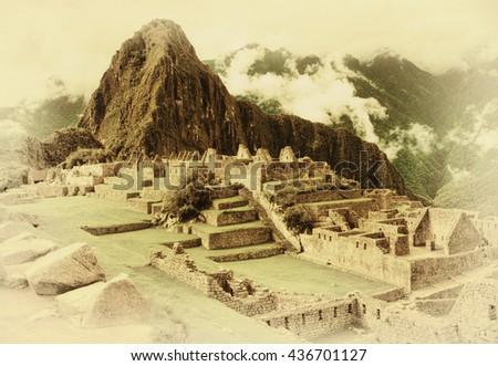 Machu Picchu Inca ruins in Peru. Vintage postcard - stock photo