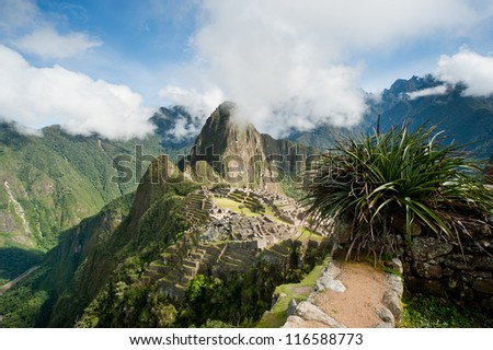Machu Picchu is a pre-Columbian 15th-century Inca site - stock photo
