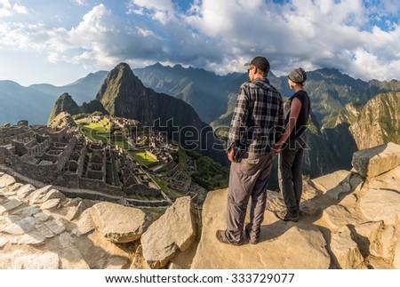 MACHU PICCHU, PERU - CIRCA 2015: A unidentified couple take a look of the citadel circa 2015 in Machu picchu, Peru. - stock photo