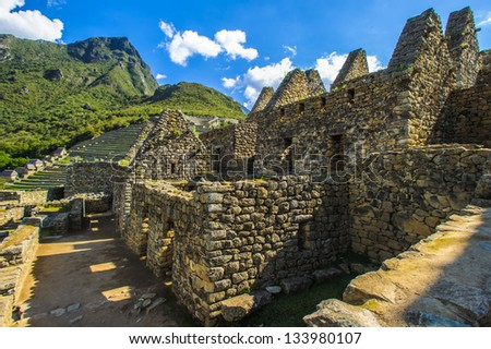 Machu Picchu rests of the inca civilization on the mountains of Peru - stock photo