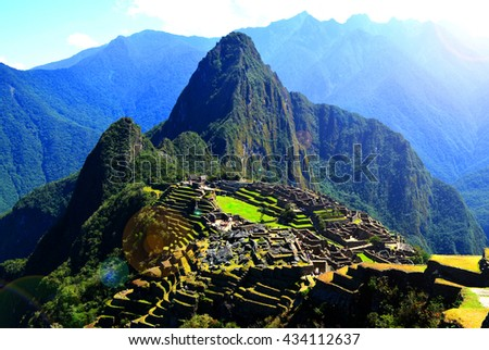 Machu Picchu with light effect, Incas ruins in the peruvian Andes at Aguas Calientes, Peru - stock photo