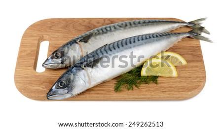 mackerel fish on wooden plate isolated - stock photo