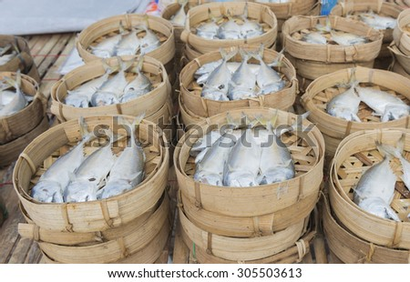 Mackerel steamed in bamboo bask.Thai gulf fish boiled cooking ready to eat pre sale in bamboo tray display for customer in tradition market thai people called this fish is platoo .select focus. - stock photo