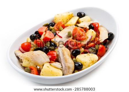Mackerels with potatoes,tomatoes,capers and olives - stock photo