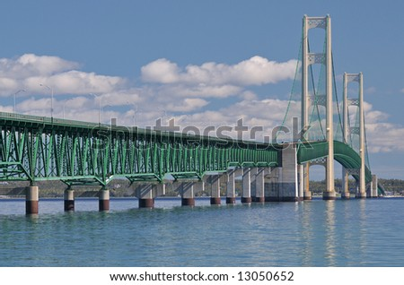 Mackinac Bridge, with reflections in the Straits of Mackinac, connecting Michigan's Upper and Lower Peninsulas, USA - stock photo