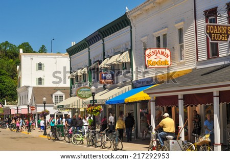 MACKINAC ISLAND, MI - JUNE 26, 2014: Picturesque shops and attractions do a brisk business in summer in this popular tourist resort - stock photo