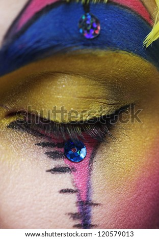Macro close-up of beautiful female eye with bright creative make-up - stock photo