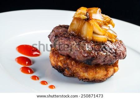 Macro close up of Japanese Hamburger with fried cabbage against dark background. - stock photo