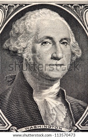 Macro close-up of Washington's Face on a one dollar bill - stock photo