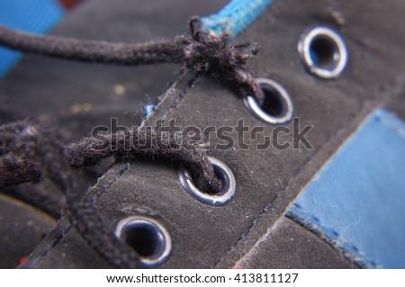 Macro close up of worn jogging shoes - stock photo