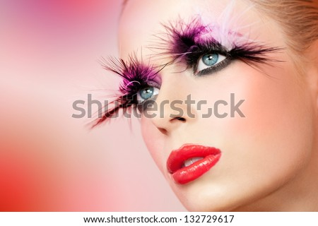 Macro close up portrait of female face with fantasy make up. - stock photo