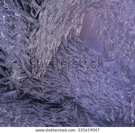 Macro, closeup of a frosty, icy glass window. Beautiful texture, pattern on a winter window after a cold night. Crystals all over. Violet. - stock photo