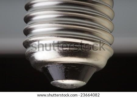 Macro closeup of a screw fitting of a light bulb - stock photo