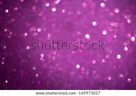 Macro closeup of abstract purple pink glitter texture. Shimmering blur background with shining lights. Vibrant color. - stock photo