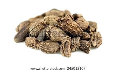 Macro closeup of cardamom seeds - stock photo
