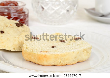 macro cut scone with raisins - stock photo