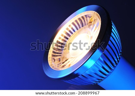 macro detail of a warmwhite COB-LED in blue spotlight - stock photo