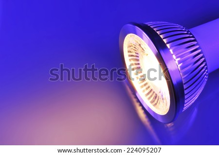 macro detail of a warmwhite COB-LED in blue-violet spotlight - stock photo