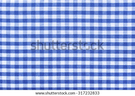 Macro detail of an original Bavarian-Franconia German cloth with typical checked pattern for shirts oder tablecloth. - stock photo