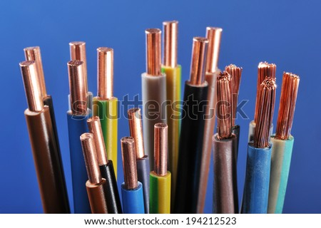 Macro detail of different stripped power cables - stock photo