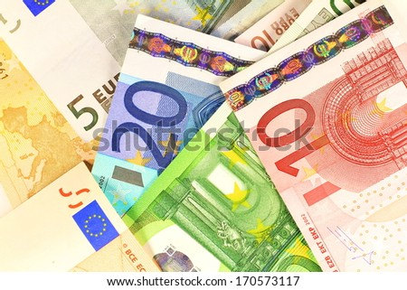 Macro details of Euro notes laid out. European currency money background.  - stock photo