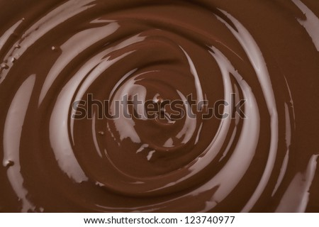 Macro image of a dark melted chocolate - stock photo