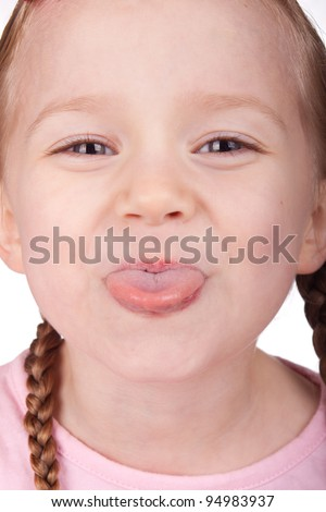 Macro image of a girl sticking her tongue out. - stock photo