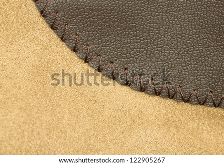 macro image of a leather patch on a suede suit - stock photo