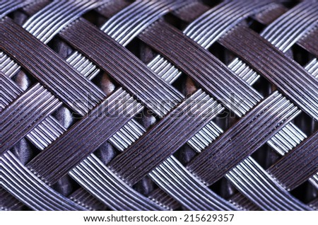 macro image of a metal wire braided reinforced hose - stock photo