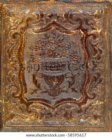 Macro Image of a well worn Gutta-Percha photo case from the 1850's. Used to house the earliest photographs, such as Daguerreotypes, Ambrotypes and Tintypes. In use 1840s-1870s (victorian era) - stock photo