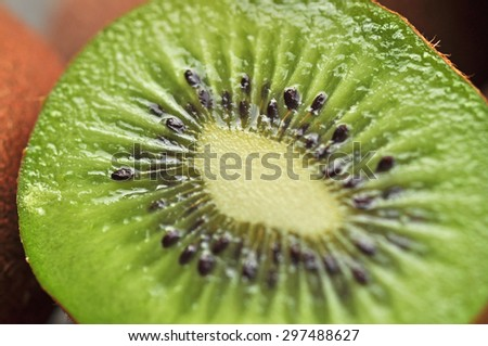 Macro kiwi flesh with selective focus. Blur style for background use - stock photo