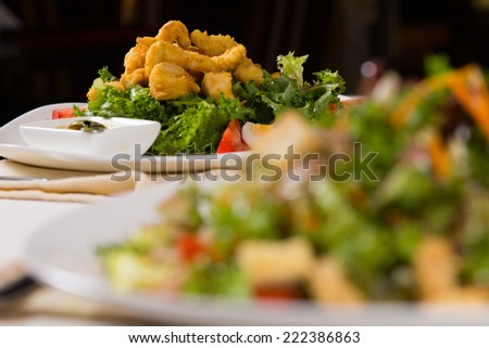 Macro Mouth Watering Fried Chicken Meat Dish on Lettuce with Tasty Dipping Sauce for Perfect Taste. - stock photo