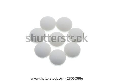 Macro of a bunch of yellow gel pills. - stock photo