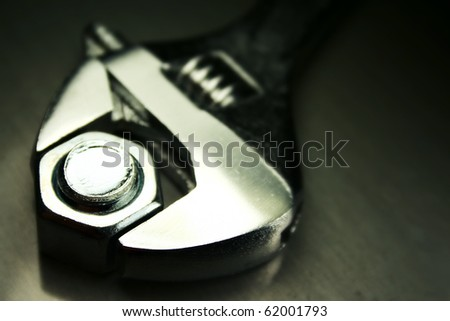 Macro of a crescent wrench - stock photo