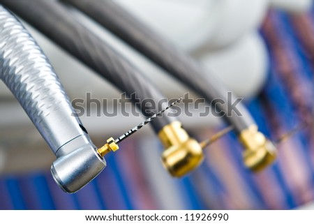 macro of a dental drill with shallow depth of field - stock photo