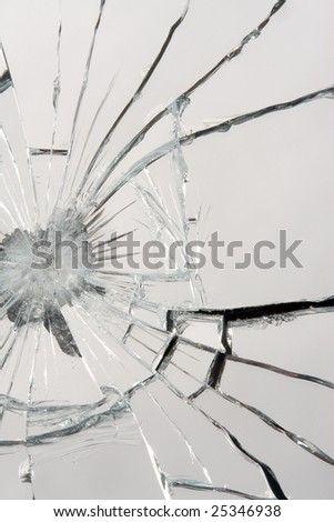 Macro of a shattered mirror. - stock photo