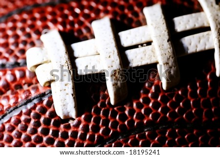 macro of american football stitching - stock photo