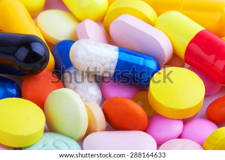 Macro of background made from pills and capsules - stock photo