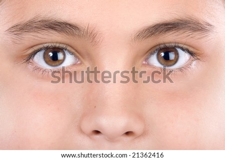 Macro of beautiful look with brown eyes - stock photo