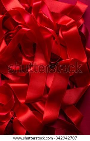 Macro of beautiful red satin ribbon background - stock photo