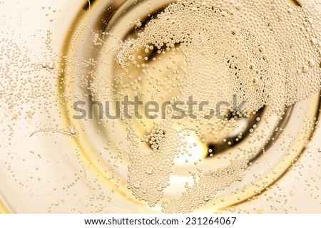 macro of champagne in a glass - stock photo