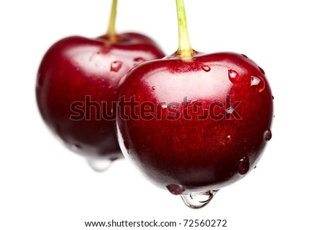 Macro of cherries with water drops isolated on white - stock photo
